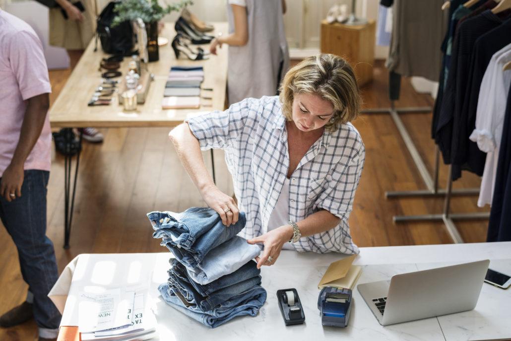 Woman folding jeans